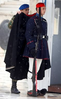 """Dignity: Greek """"Evzones """" won't move when on duty even in heavy rain. Soldier putting a coat on Greek parliament guard Mykonos, Greek Men, Greek Life, Unknown Soldier, Greek Culture, Acropolis, Athens Greece, People Of The World, Ancient Greece"""
