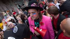 Members of Arcade Fire and local New Orleans legends Preservation Hall Jazz Band held a second line parade for David Bowie on Jan. 16/16, and it effectively shut down the French Quarter in New Orleans. (Photo of Win Butler)