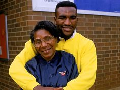 Evander Holyfield w/ his mom Annie in 1987. He was born on 10/19/1962, in the mill town of Atmore, Alabama. The youngest of 9 children, Holyfield and his family moved to Atlanta, where he began boxing at age 12 and won the Boys Club boxing tournament. At 13, he qualified to compete in his first Junior Olympics. By age 15, Holyfield became the Southeastern Regional Champion, winning this tournament and the Best Boxer Award. By 1984 he had a record of 160 wins and 14 losses, with 76 KO.