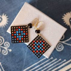 Have a look at how I used the unusual pairing of plastic canvas and nail polish to make these fun earrings!
