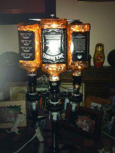 JACK DANIELS 4 BOTTLE LIGHT HANGING ON A CHROME BAR BUTLER