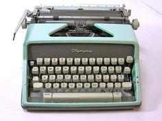 Aqua Blue Olympia De Luxe Manual Typewriter.
