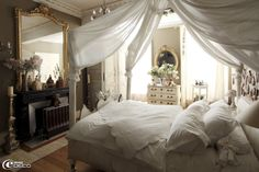 Another pretty French room, These curtains would make your bed feel cozy despite the cathedral ceilings in your room
