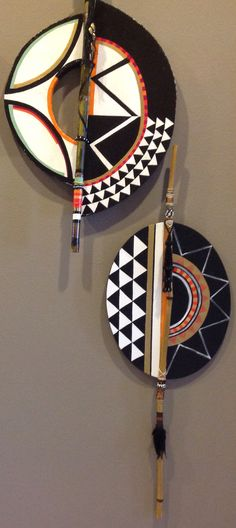 Love these Contemporary African shields with embellished bamboo poles by Arterior Dimensions.