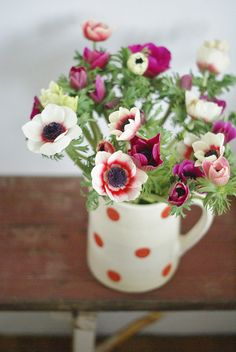 Love the polka dot mug! Could buy mugs at dollar store and decorate with sharpies. Then fill with dollar store silk flowers in bright fun colors