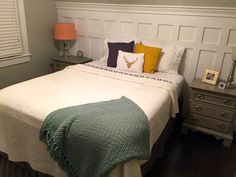 Love the board and batten look? Achieve this style in a custom DIY headboard for a fraction of the cost using moulding.