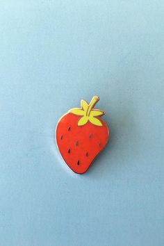 """Cute little strawberry cloisonné pin by designer Tuesday Bassen Perfect for an accent on your lapel, backpack, or blouse. Approx 1.5"""" tri-colored enamel on rose gold tone metal with clasp back. Locking pinbacks also available"""