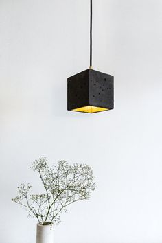 Concrete gold design lamp hanging lamp B1dark by GANTlights, €135.00. This version of the B1 concrete lamp is laced with black Pikment and has so dark grey to anthracite.  The lamp is cast in simple concrete in simple cubic form.