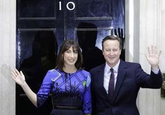 Britain's Prime Minister David Cameron and his wife Samantha wave from the steps of 10 Downing Street in London Friday, May 8, 2015 after meeting Britain's Queen Elizabeth II where he informed her that he has enough support to form a government. The Conservative Party swept to power Friday in Britain's Parliamentary elections winning an unexpected majority.