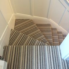 Choosing Stair Runner : Awesome Winder Stair Design With Striped Carpet Stair Runner Combine With White Newel Post And Wall Striped Carpet Stairs, Stairway Carpet, Striped Carpets, Tile Stairs, Flooring For Stairs, House Stairs, Carpet Stair Treads, Stair Rugs, Stairs In Kitchen