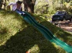 slide in the ground. like doing log-rolls down the hill, but less grass stains. Outdoor Fun For Kids, Backyard For Kids, Backyard Slide, Kids Play Spaces, Kids Play Area, Outdoor Projects, Garden Projects, Natural Outdoor Playground, Outdoor Play Equipment
