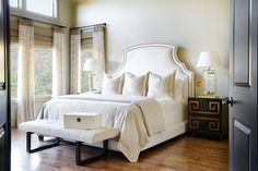 Choose a neutral paint color like Favorite Tan (SW 6157) to create a warm and inviting bedroom.