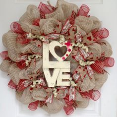 Valentines Day Wreath Love Button Natural Burlap Handmade Deco Mesh. New, Large, Premium Valentines Day wreath. A large, cream, rustic wood LOVE sign rests on a bed of creamy twine and natural burlap striped deco mesh. The sign is decorated with adorable red and pink buttons. The inner is decorated with burlap ribbons with white Valentine wording and gorgeous burlap canvas ribbons with gold accents and red hearts. The outer ring has soft, red fluted mesh with natural burlap stripes and...