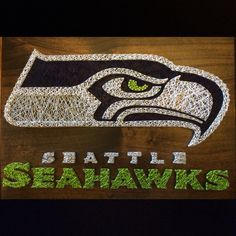 Seattle Seahawks string art! Choose your favorite team and we'll make it for you! https://www.etsy.com/listing/222041118/custom-sports-team-logo-string-art-shown