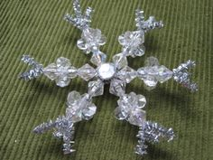 Bead lovers and snow craft fans alike will be rushing to their craft drawers to get ready to make a snowflake like this. This gorgeous handmade Christmas ornament is very inexpensive to make, but looks like a true work of art on your tree.