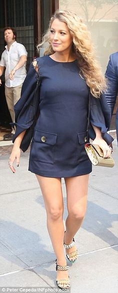 Bumping along: The28-year-old pregnant actress scintillated in a navy mini dress