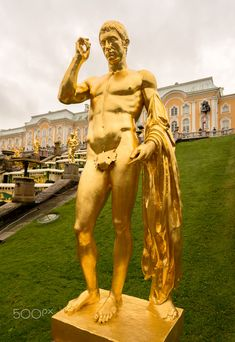 Golden statue by the main cascade or fountain at Peterhof Palace in St Petersburg, Russia
