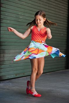 Boutique kids clothes from TwirlyGirl.  This is our Reversible Racer Dress, and it sure is twirly!  Click to see the other side.