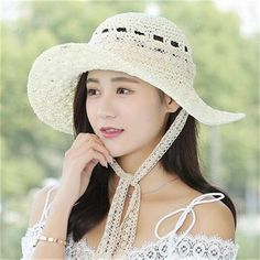 eb747499cf1 Hollow straw sun hats for women UV travel wide brim beach hat with lace tie  packable