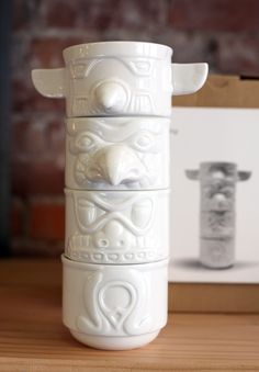totem cups by rob southcott...I dig these. Seeing the totem poles in Alaska has been one of my favorite travel memories