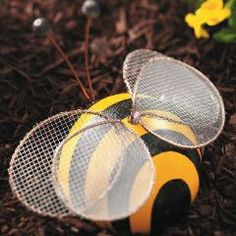 Bowling Ball Bumblebee  Add some color to your garden with this painted bowling ball bumblebee.