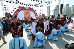 Boys participate in the traditional Chinese coming of age ceremony sponsored by China Yellow River Television. Each boy receives a crown to symbolize become a man. This event was held during the 2nd Annual Shanxi Radio and TV Carnival.