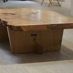 We recently made this Nakashima inspired coffee table in Oak. The top is bookmatched. It slides onto sliding dovetailed legs from either side. The bow ties in the end (in walnut) hold the top two pieces together with a slight gap down the middle.