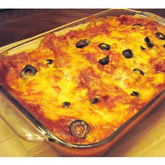 Cottage cheese lends a lighter texture to chicken and cheese enchiladas, bathed in classic red enchilada sauce.