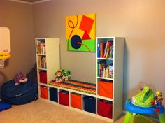 Kids playroom! Great storage for small toys and a reading area! I would do this around the window