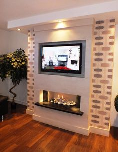 Modern wood fireplace wall fireplaces fire places electric for sale the deluxe in limestone with lights . Fireplace Tv Wall, Fireplace Surrounds, Wall Fireplaces, Modern Fireplaces, Fireplace Ideas, Fire Surround, Electric Fires, Living Room Tv, Apartments Decorating