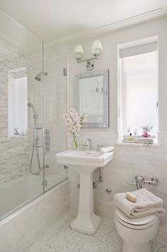 Small bathroom, pedestal sink, glass shower tub, small window, rectangle mirror | Frances Herrera Interior Design