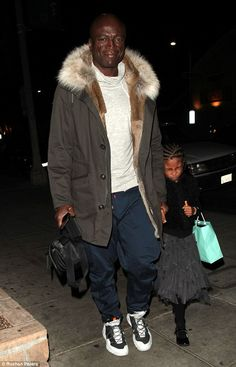 No big deal:In comparison, ex Seal showed up in a markedly casual getup for the family affair, donning some white trainers, athletic pants and a white sweater. He layered an olive, fur-collared parka on top