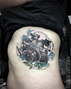Sketch work camera tattoo on the right side ribcage.
