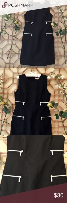 """Michael Kors black dress with white zipper detail. This black Michael Kors dress has 4 white functional zippers with the MK name on them. The dress is 62% cotton and 38% nylon. No tears, stains etc. almost new condition. Length is 35"""" and bust is 17 1/2"""" Michael Kors Dresses Midi"""
