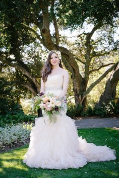 Bride with Strapless, Blush Ruffled Gown | Photo: Karlisch Photography. View More:  http://www.insideweddings.com/weddings/modern-rustic-wedding-full-of-flowers-and-geometric-details/906/