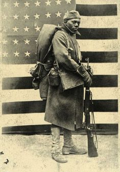 Moment - consequential - Consequential is something important; significant. This image is significant because its a picture of an African American from World War II. Its a part of history and serves as an evidence of the terrible chaos. This image contains balance and line as well.