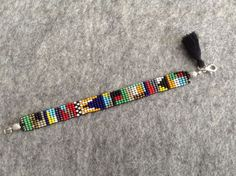 Colorful Bead Bracelets Made of colorful sand beads. It has a total length of cm and a width of Loom Bracelet Patterns, Bead Loom Bracelets, Bead Loom Patterns, Beading Patterns, Seed Bead Jewelry, Bead Jewellery, Diy Jewelry, Beaded Jewelry, Diy Schmuck