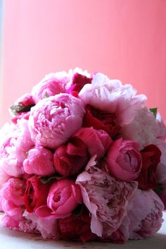 Beautiful Peonies and David Austin Roses in vibrant shades of pink.