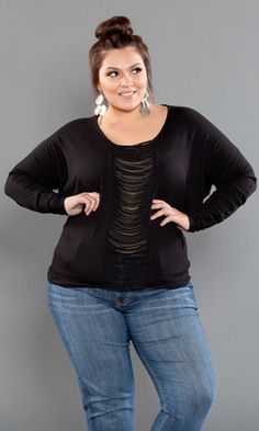 Unexpectedly sexy, Plus Size Ashley Top is a stylish and daring top offering quick glimpses of skin. The perfect top for a night out on the town. Try Ashley with jeans and your favorite heels or black pants for an ultra-chic look.