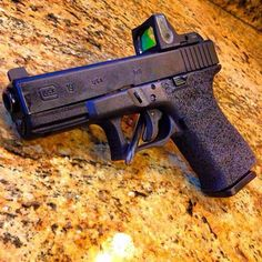 Glock 19 w/grip reduction + grip stippling + Trijicon RMR + suppressor sights