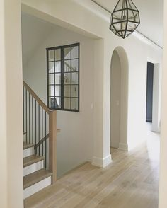 Love these stairs and simple railing. Wall color is BM Classic Gray.