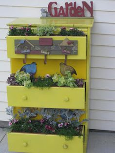use an old beat up dresser as a plant stand in the back yard! love it!
