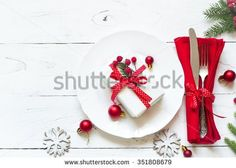 Christmas table setting with christmas decorations and gift at white table. Top view.