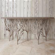 This stunning white oak mesquite console table features a beautiful base made of silver metal leaf finish. | King Ranch Saddle Shop