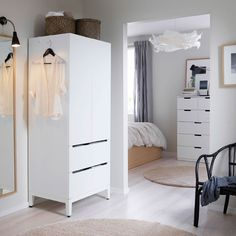 A white wardrobe with two doors and two drawers.