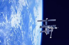 """September 15, 1995:    Space Station Mir Over Earth  -    Credit: NASA, Russian Space Research Institute  -    Explanation: This picture of the Russian space station Mir over the Pacific Ocean was recorded by the Space Shuttle Discovery in February 1995. During this mission Discovery performed a rendezvous and """"fly around"""" with Mir in preparation for a future docking mission.    More..."""