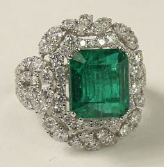 Ladies Beautiful Approx. 5.80 Carat Emerald, 3.0 Carat Diamond and 18 Karat White Gold Ring. Emerald with Vivid saturation of Color. Diamonds E-F Color, VS Clarity. Signed 18K.