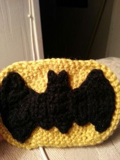 Batman symbol I crochet for a beanie I do not know how to or even read a pattern I just winged it. Im a beginner so I just saw the the picture and went for it.