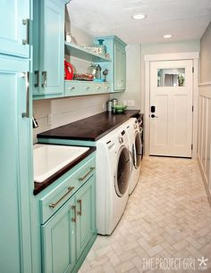 Beautiful Laundry Room floor Tile love the colorful cabinets and folding shelf. so perfect.