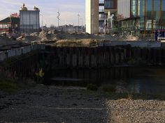 https://flic.kr/p/ijeMbM | View on the Oosterdok waterfront in Amsterdam city with the last excavation site on the location of the demolished Post building, opposite the Science Center Nemo; location Oosterdokseiland - urban photography by Fons Heijnsbroek, the Netherlands, 2013 | View on the Oosterdok area in Amsterdam city, with a close-up photo of the last excavation site there, on the former  location of the demolished Post building, opposite the foot-bridge to Science Center Nemo. To…